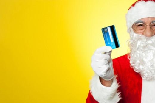 """""""Cropped Image Of Aged Santa Holding Credit Card"""" by stockimages, courtesy of freedigitalphotos.net"""