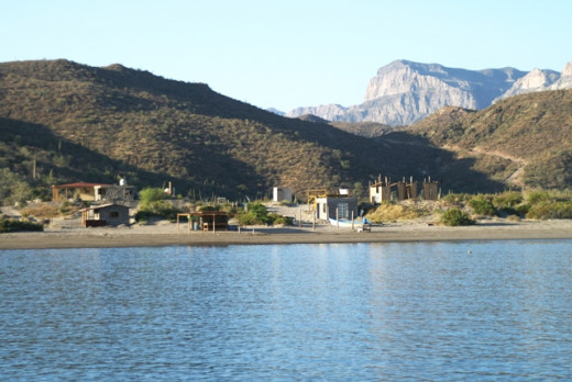 New houses and progress growing on the south shore of San Evaristo Bay in April 2009