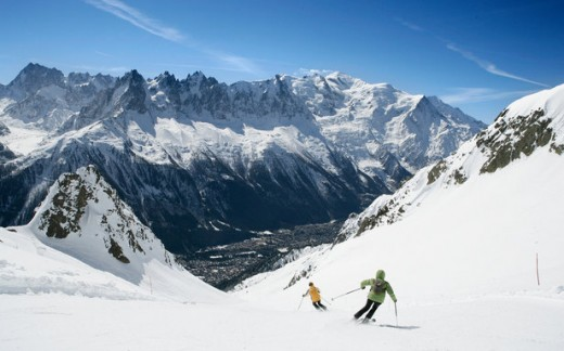 A view of skiers gliding down the picturesque landscape.