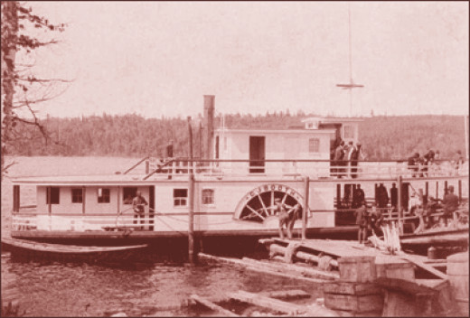 A riverboat pulling lumber on the St. Johns River which forms the border between Maine and New Brunswick in the tip of Northern Maine.
