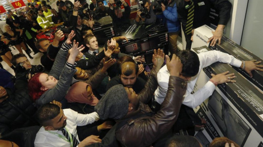 It looks like a scene from the zombie apocalypse but it's worse - It's Black Friday and these are living humans, supposedly in full control of their faculties.