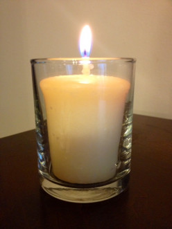 Vanilla candle in a clear, glass votive holder.  Perfect for a nice ambiance.