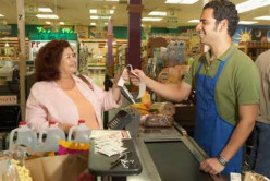 A clerk who LOVES to be called off his lunch break to deal with a customer. (See his fake smile?)