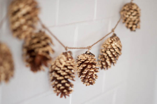 Golden pine cone garland