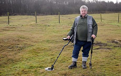 Terry Herbert stands near the finds with his metal detector