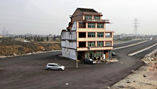 The Wenling nail house obstinately standing alone - in the middle of a road