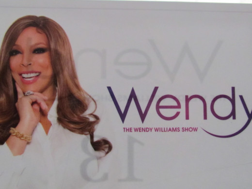 A poster that is displayed of Wendy, as you enter her studio