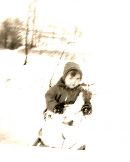 This is a picture of me playing in the snow. I'm not sure what year. My guess is 1960-61.
