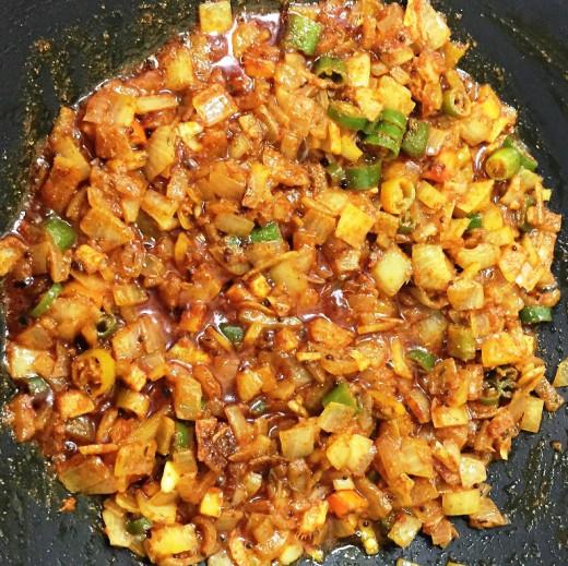 Add finely sliced ginger, shah jeera, red chili powder,coriander powder and garam masala powder.
