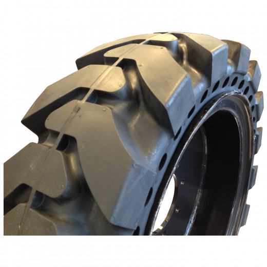 This solid skid steer tire has a deep tread, aperture holes, and is pressed onto a steel hub.