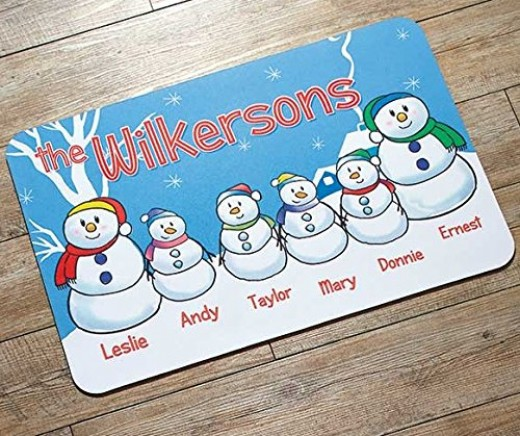 This snowman doormat can be personalized with your family's names.