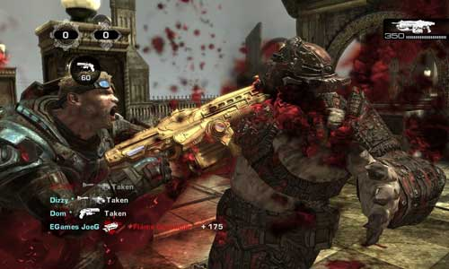 Gears of War Player Graphically Sawing into Head of Enemy with Chainsaw Attached to Gun