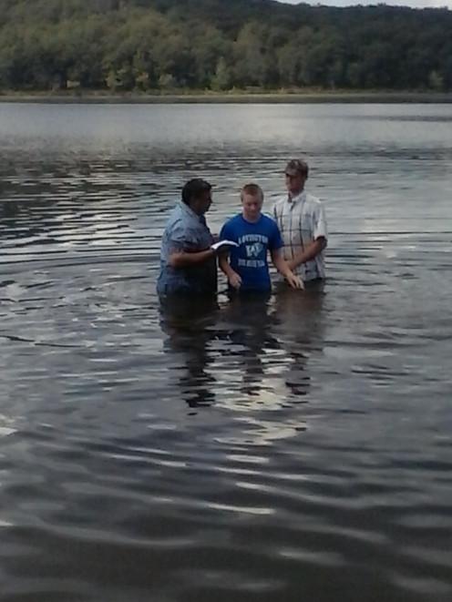 Caleb getting baptized.
