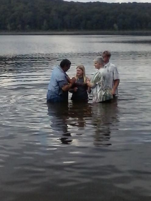 Michaela getting baptized.
