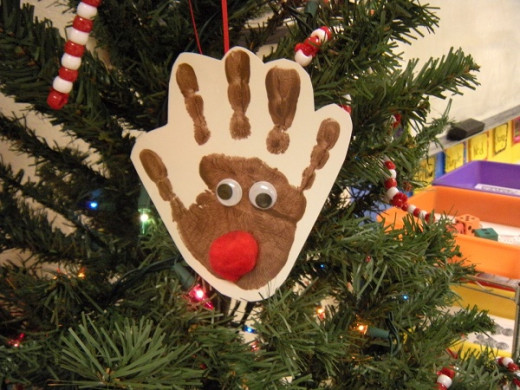 Love these handprint ornaments!  They are fun to make crafts kids can make and they become family treasures as the years go by.