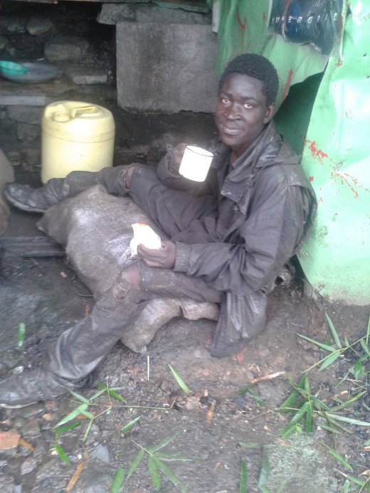 A street 'youth' taking tea in one of the makeshift hotels on the streets of Nairobi.