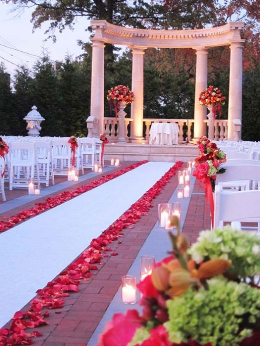 Set the mood of love and romance with rose petals on your aisle runner.