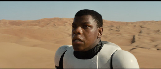 Actor John Boyega Playing Finn:  The Storm Trooper.