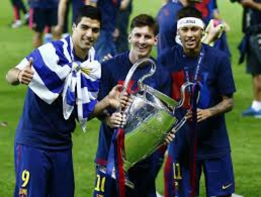 Messi, Neymar and Suarez after last years Uefa Champions League win