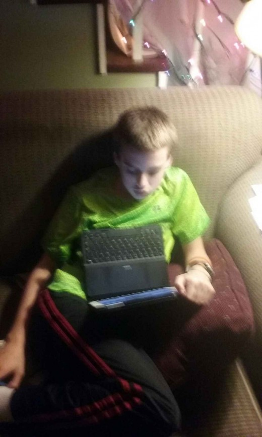 My son watching a Christmas video on his i-pad.  I still pray for him every day.