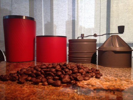 From left to right; Cup, Pourer, Grinder and Filter