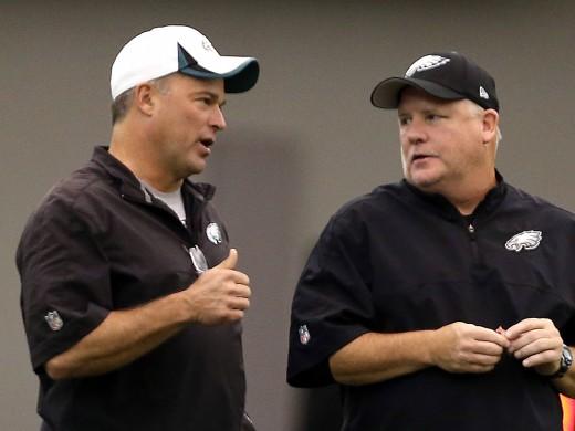 Philadelphia Eagles defensive coordinator Bill Davis (L) and head coach Chip Kelly (R)