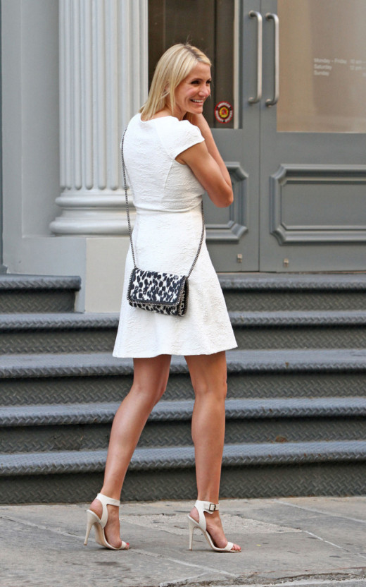 Cameron Diaz shapely pins in a short white dress and high heels