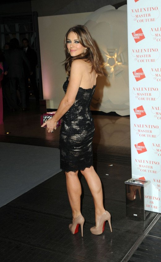 Elizabeth Hurley always stylish and classy wearing a black lace mini dress and platform pumps