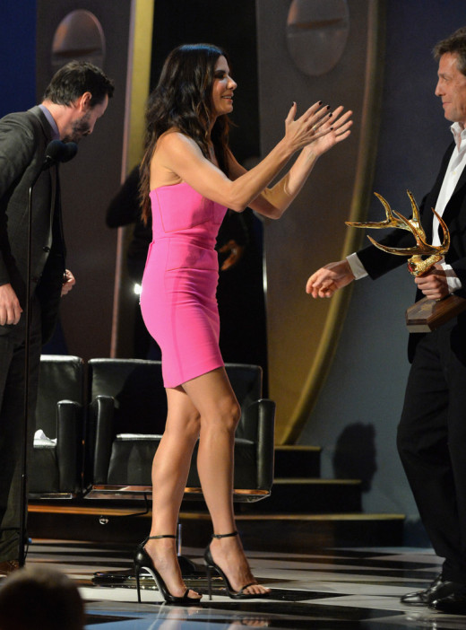 Sandra Bullock gorgeous legs in a pink mini dress and towering heels