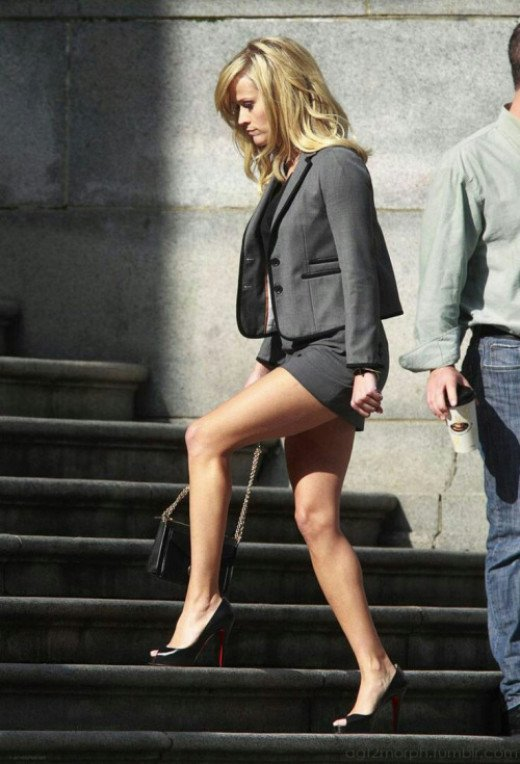 Reese Witherspoon sexy legs in a short skirt business suit and black pumps