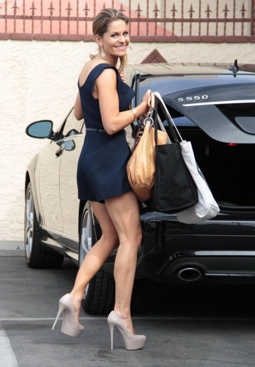 Candice Cameron Bure has gorgeous legs in a short romper and sky high pumps