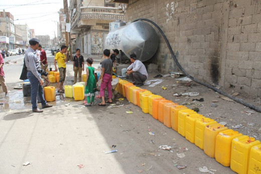 A Long Queue of Empty Water Jerrycans