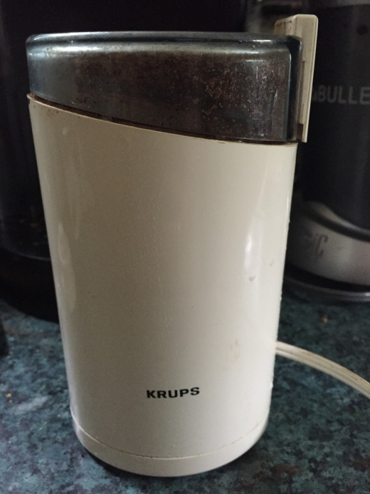 A coffee grinder can be used to grind herbs. You can then brew tea to add to your washing water. Just remember - use a separate grinder for herbs that you may not wish to consume.