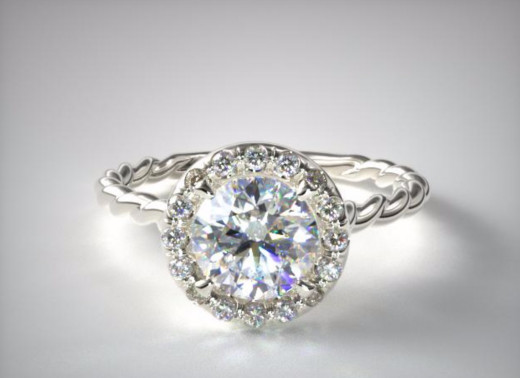 David Yurman doesn't have the entire market on cabled engagement ring settings. Visit ringvoyeur.com to see who makes this great looking ring.