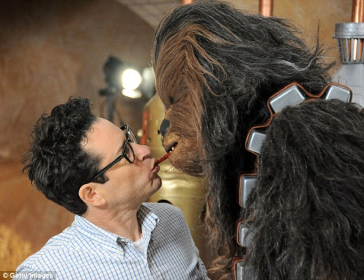 Abrams (left) going mouth-to-mouth with Peter Mayhew's Chewie/Chewbacca. Furball bromantic love.