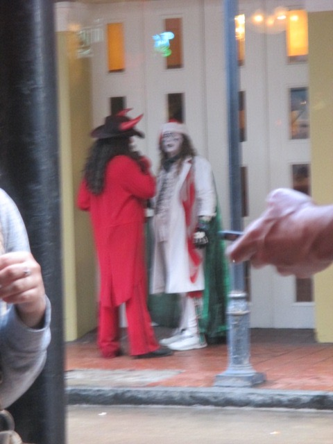 Father Christmas and the Devil seen from the window of ACME Oyster House