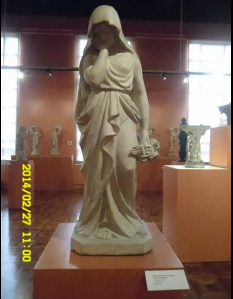 Mourning Woman with a Bouquet; ISABELO L. TAMPINCO; Polychrome concrete