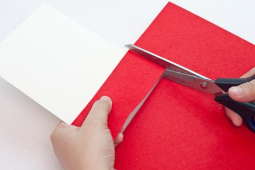 Step 2.  Cut a strip of red felt.  The width should be at least 1.25 to 1.50 inches.  The length of the felt  should be as wide as the cover of your folded stock paper.