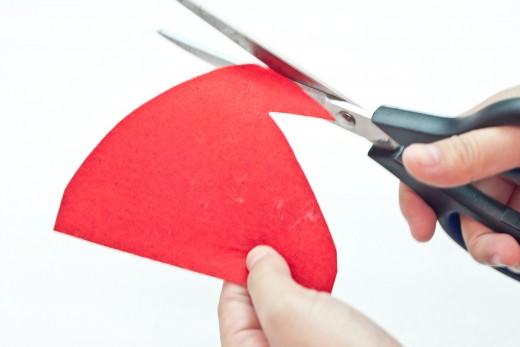 Step 16.  Cut a Santa cap from the red felt.