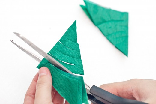 Make curvy cuts in your green triangle.