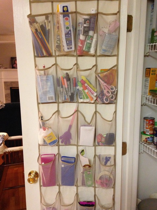 Art supplies hang in my pantry door so my kids keep art at the kitchen table: idea stolen from Pinterest.