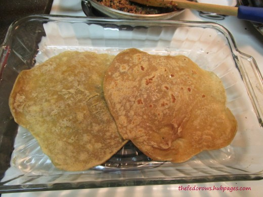 First, lightly grease and add two tortillas.