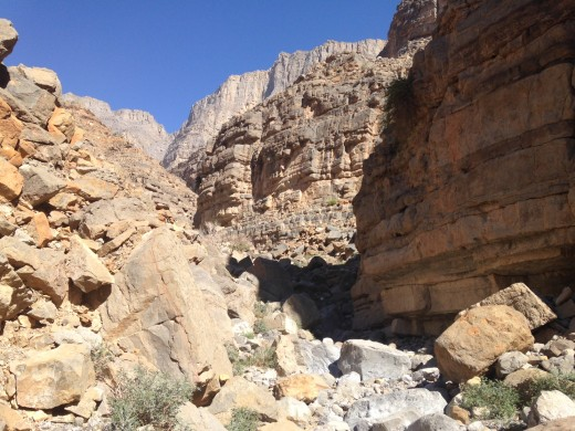 Follow the natural bends of the wadi floor