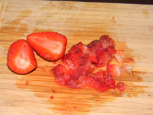 Chop the strawberries into small pieces
