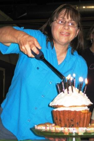 Me lighting the birthday cake muffin. It is frosted with Cool Whip to hold it together.