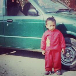 Cute little Priyankar posing near the car. Khoob Bhalo :)