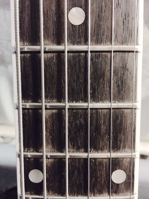A quick photo I took of frets 9-12 on my friend's beautiful Gibson Nighthawk.