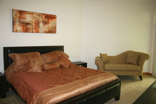 The painting above the bed was inspired by the colours of the furnishings and was created with some dashes of texture.