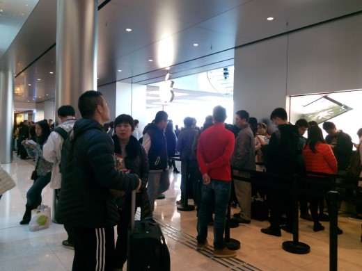Queues form outside of the Apple Store in IFC Plaza, Hong Kong
