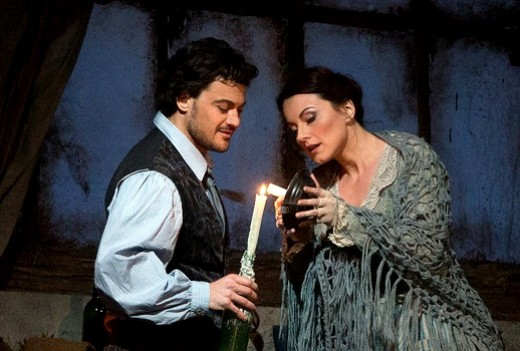 Mimi Lighting her Candle in La Boheme Production